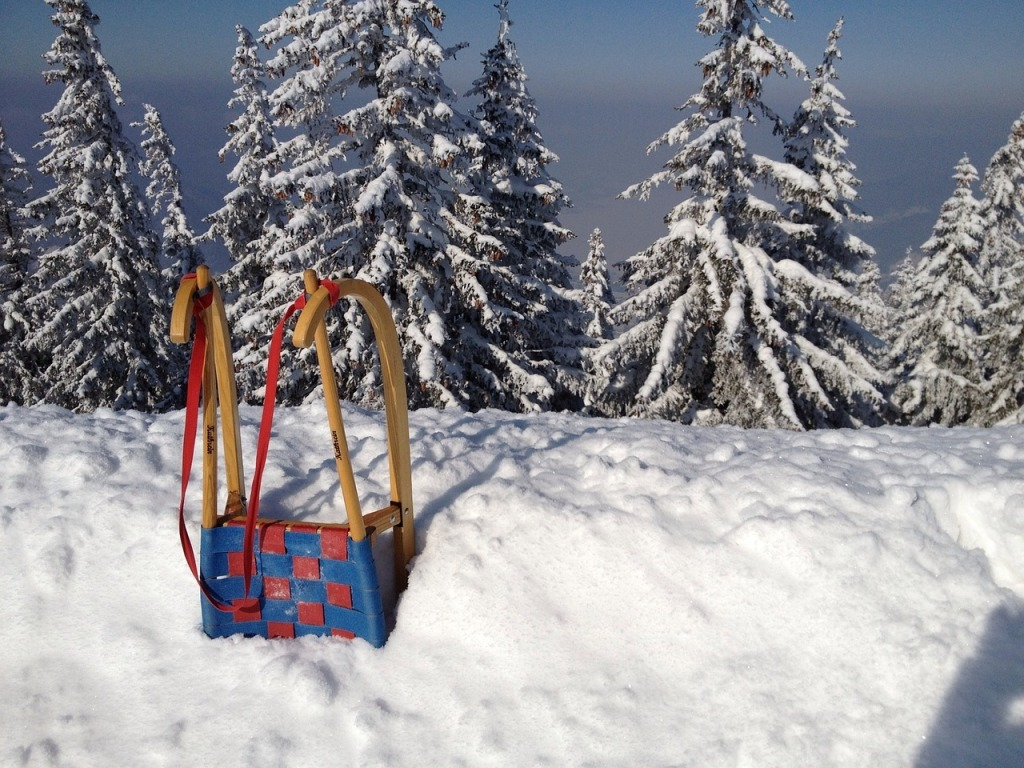 Schlittenfahren im Winterurlaub im Salzburger Land